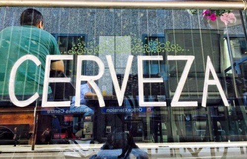 "Chalkboard art on the windows of the Merchant Tavern, Toronto. This says ""Cerveza"" or beer in Spanish."