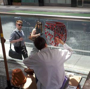 Alison Garwood-Jones painting the windows at The Merchant Tavern, Toronto